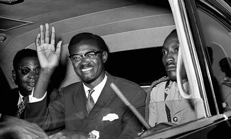 Congo premier Patrice Lumumba waves in New York in July 1960 after his arrival from Europe. Photograph: AP