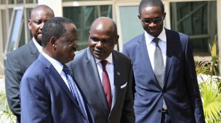 NASA presidential candidate Raila Odinga, IEBC Chairman Wafula Chebukati and CEO Ezra Chiloba