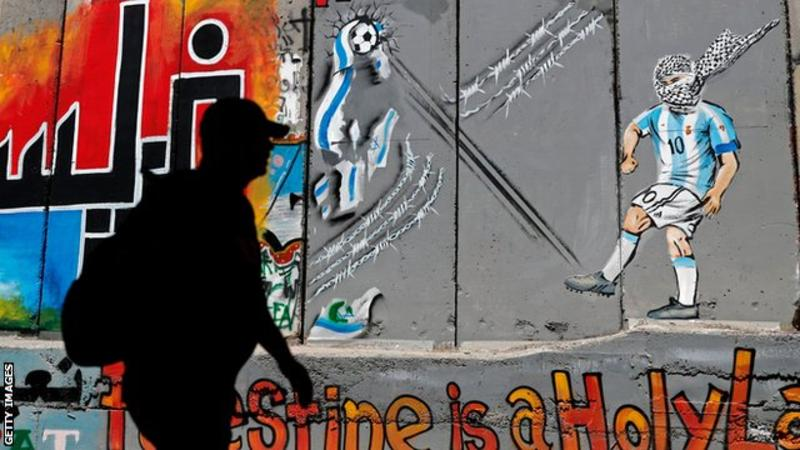 Lionel Messi was featured in a mural painting on Israel's separation barrier in the occupied West Bank city of Bethlehem, kicking a ball which destroys the Israeli flag