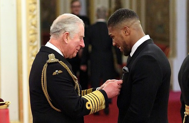 Joshua awarded OBE by Prince Charles