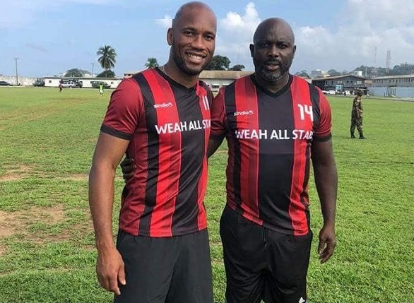 Didier Drogba joins Liberian President George Weah for a charity game