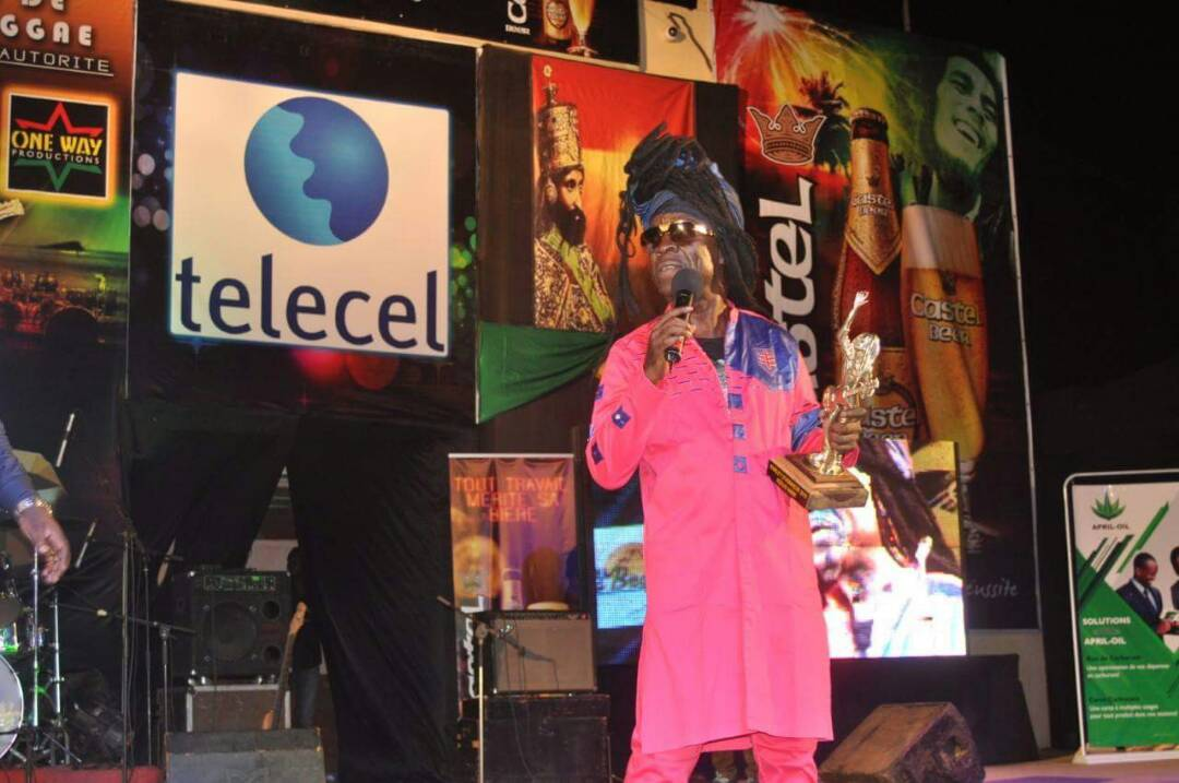 'The Maestro', the 'Music Man', Kojo Antwi, with the award on stage in Burkina Faso