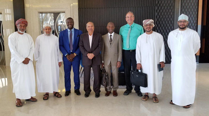 Dr. Owusu Kizito, Chairman/CEO of Investigroup ( 3rd from left) with Dr. P Mohamed Ali ( fourth from left) - A multi-billionaire industrialist and Chairman of MFAR Group of Companies), Dr. Peter Ikre, CFO of Investigroup, Christian Piendl- German Consultant, Humaid Al Habsy- Investigroup's local representative, Mohiudin Mohammed Ali, VP of GALFAR. First and second from left include Ahmed Al Habsy and Dr. Salim.
