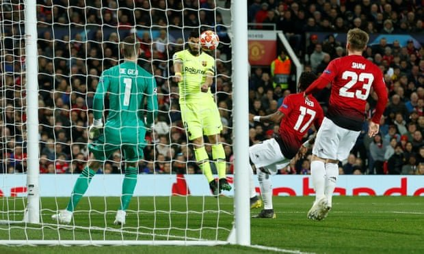 Luis Suárez heads the ball across goal – it would strike Luke Shaw on the shoulder and go in at the back post. Photograph: Andrew Yates/Reuters