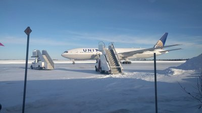 Passengers stuck on flight in frigid cold for over 14 hours