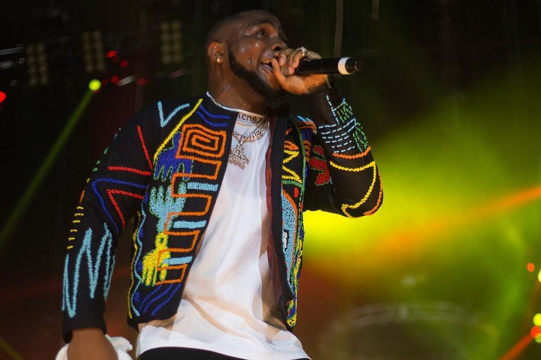 Image result for davido lowered onto the stage in a concert