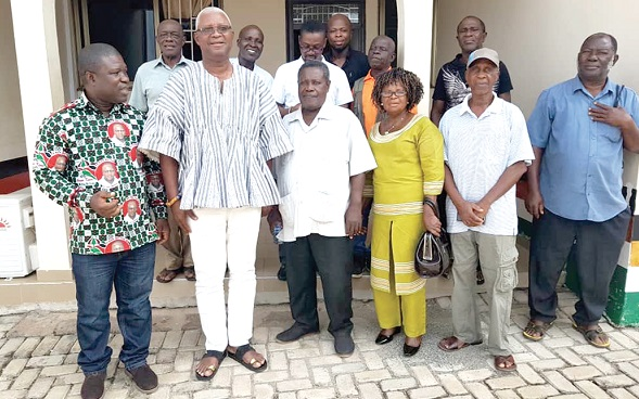 The Chairman of the Cadres, Mr Frank Adoba (3rd left) with Mr Henry Ametefee (2d left), Volta Regional Chairman of the NDC and other members of the party
