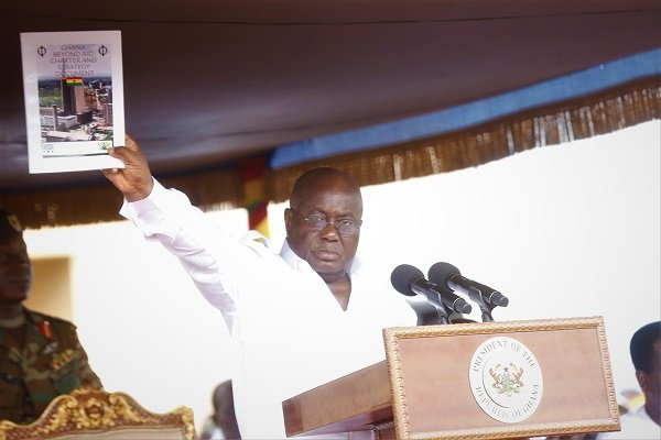 President Akufo-Addo displaying the Ghana Beyond Aid document at the May Day celebrations in Accra