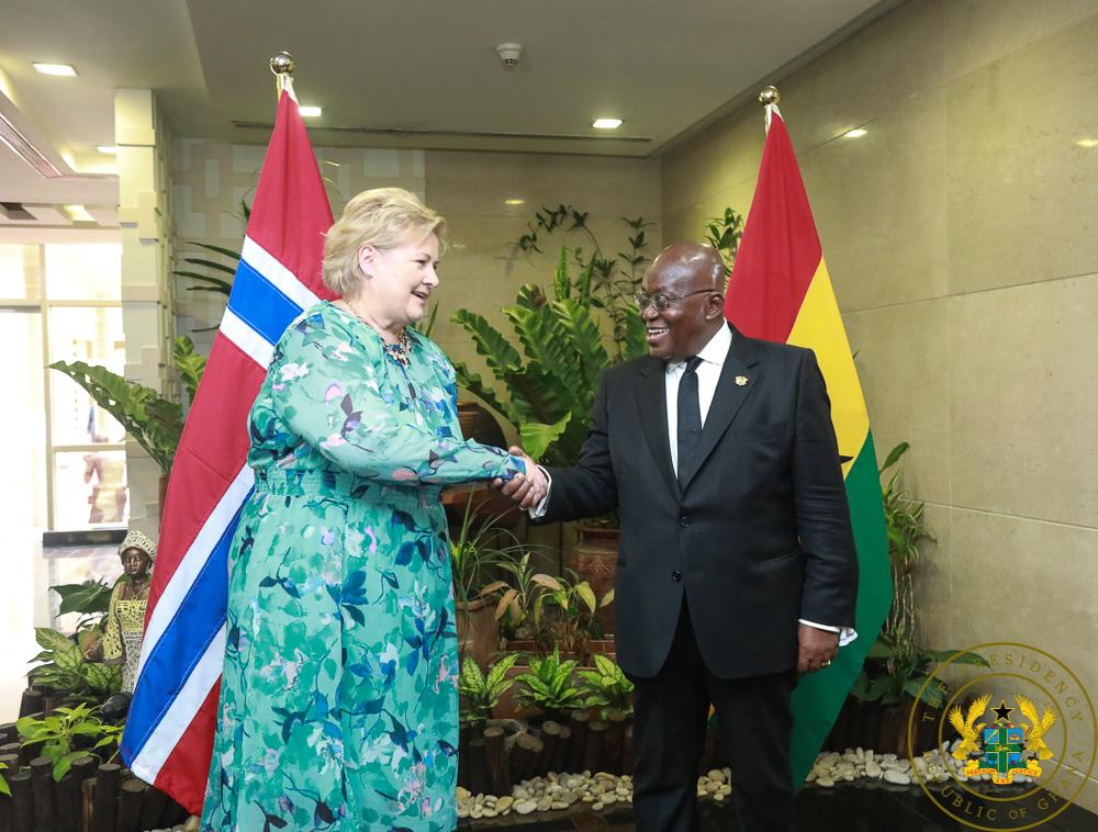 PM Solberg [L] in a handshake with President Akufo-Addo
