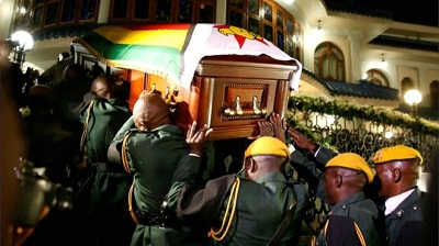Mr Mugabe's casket arrives at the Blue Roof, his residence in Borrowdale, Harare