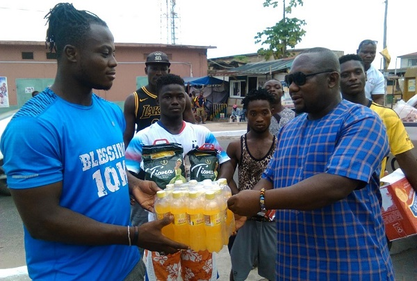 Champion lifter Amoah (left) receiving his items from John Vigah, Communications Director of GWF