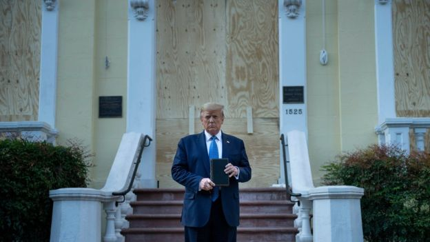 Mr Trump posed in front of a damaged church shortly after police used tear gas to disperse protesters nearby