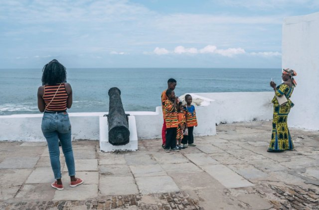 Tourists pose for pictures at the Cape Coast Castle in Ghana on Aug. 18, 2019