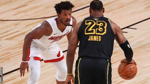 Jimmy Butler pays close attention to LeBron James in game five of the NBA finals