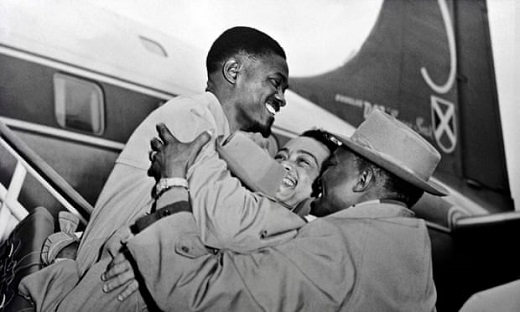 Patrice Lumumba, left, is welcomed at Brussels airport in January 1960. Photograph: AFP/Getty Images