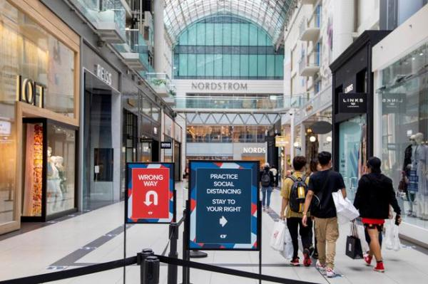 FILE PHOTO: People walk in the Eaton Centre shopping mall, as the provincial phase 2 of reopening from the coronavirus disease (COVID-19) restrictions begins in Toronto, Ontario, Canada June 24, 2020.