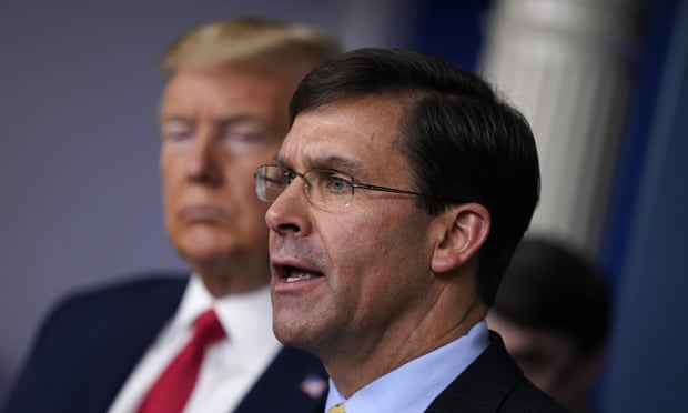 Donald Trump with Mark Esper in March. Christopher C Miller, the director of the National Counterterrorism Center, will replace Esper as acting defense secretary. Photograph: Evan Vucci/AP