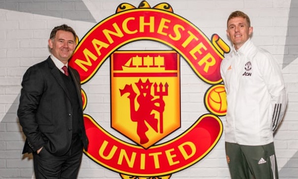 John Murtough and Darren Fletcher pose after being named Football Director and Technical Director of Manchester United. Photograph: Ash Donelon/Manchester United/Getty Images
